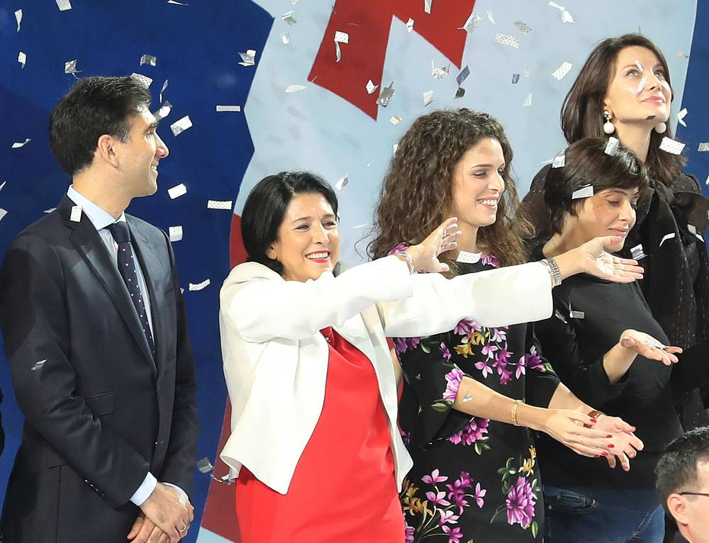Georgian presidential candidate Salome Zurabishvili waves during an election campaign meeting with her supporters in Tbilisi, 2018