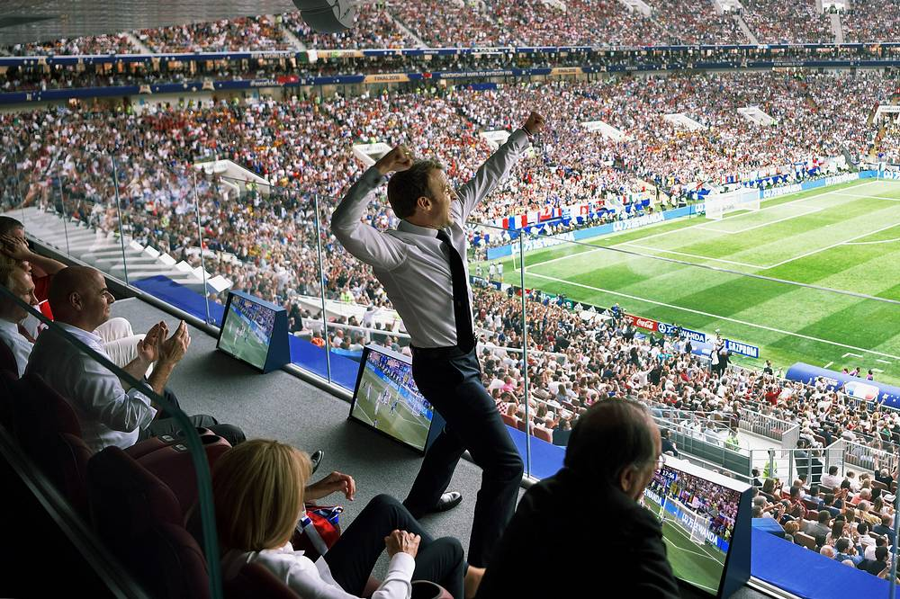 France's President Emmanuel Macron celebrates a goal as FIFA President Gianni Infantino looks on at the final match of FIFA World Cup Russia 2018 between France and Croatia at Luzhniki Stadium