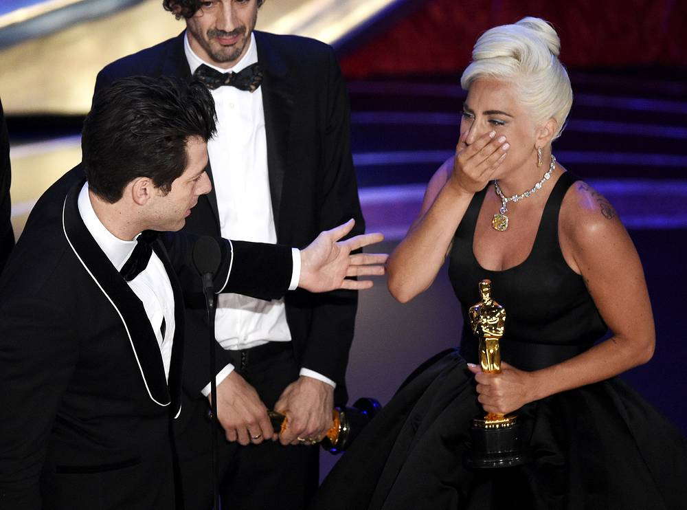 """Mark Ronson, Anthony Rossomando and Lady Gaga accept the award for best original song for """"Shallow"""" from """"A Star Is Born"""""""