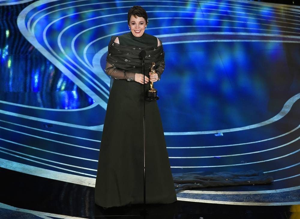 "Olivia Colman accepts the award for best performance by an actress in a leading role for ""The Favourite"""