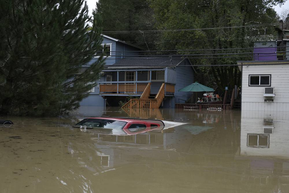A truck is seen submerged in the flood waters of the Russian River in Forestville