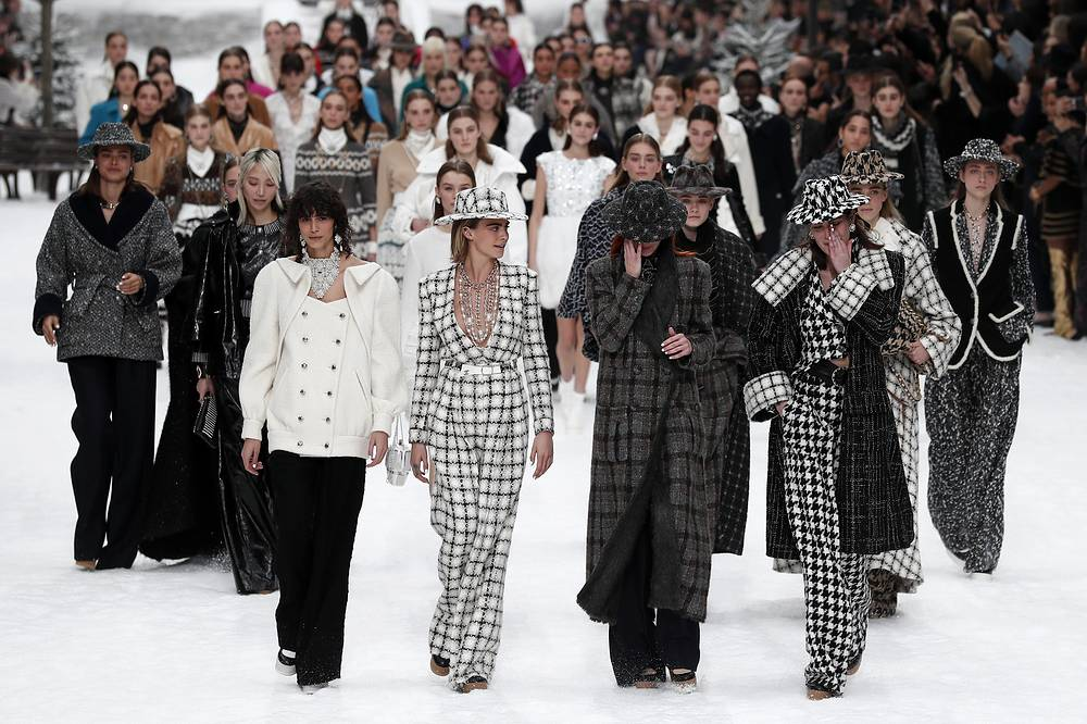 British model Cara Delevingne, Argentinian model Mica Arganaraz and crying models pay tribute to the late German designer Karl Lagerfeld after the presentation of the Fall/Winter 2019/20 Women's collection of Chanel fashion house during the Paris Fashion Week, March 5. Karl Lagerfeld died aged 85 on February 19, 2019