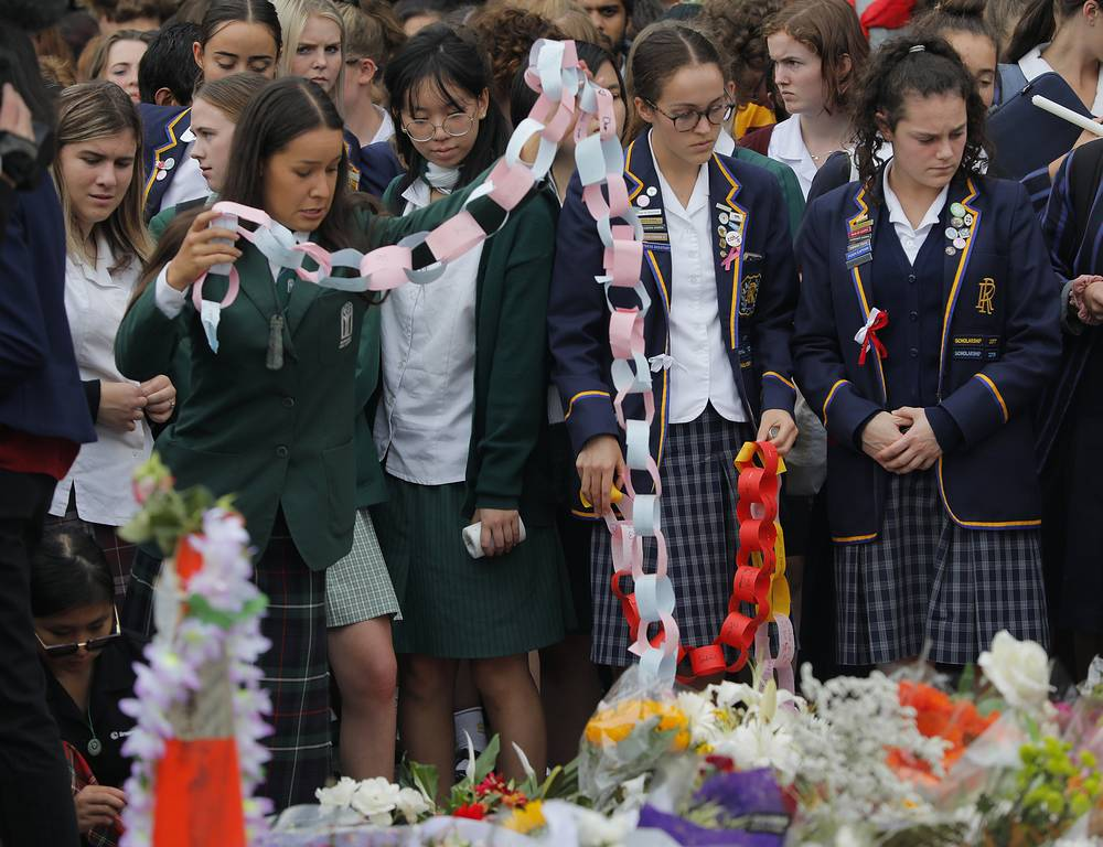 Students pay their respects during a vigil to commemorate victims of the  shooting, outside the Al Noor mosque in Christchurch