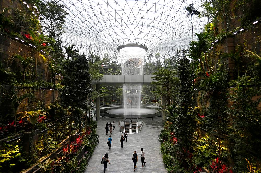 The 40-metre high Rain Vortex, which is the world's tallest indoor waterfall, is seen from inside Jewel Changi Airport in Singapore, April 11