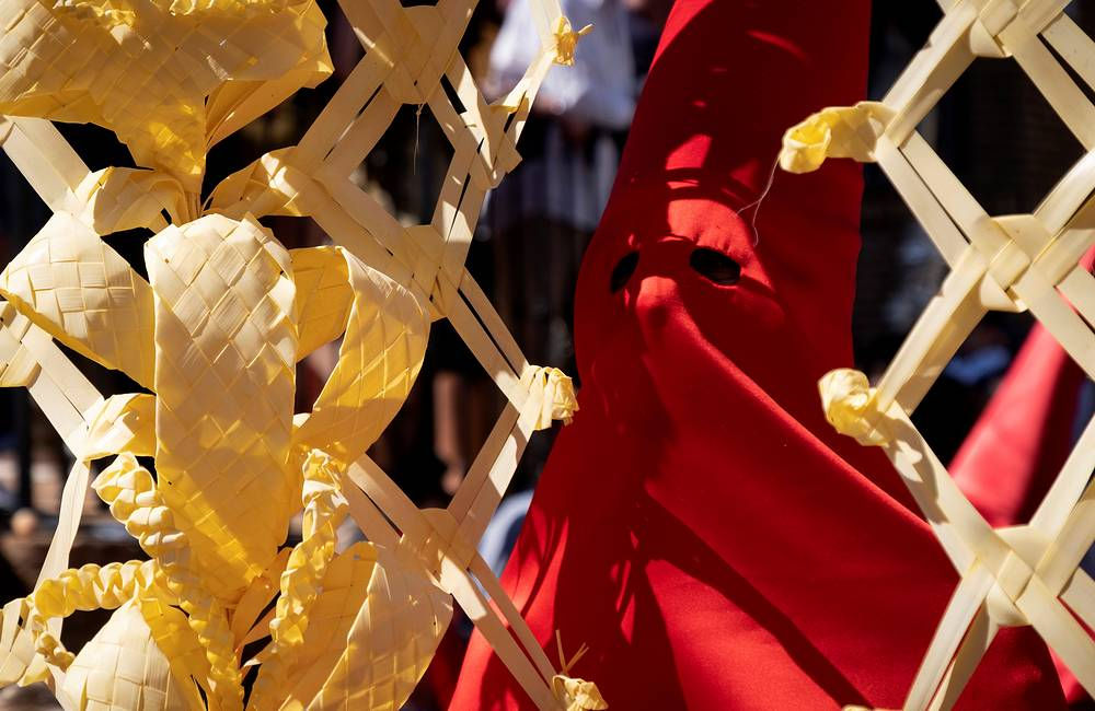 A 'nazareno' or masked participant attending a Palm Sunday procession in Huelva