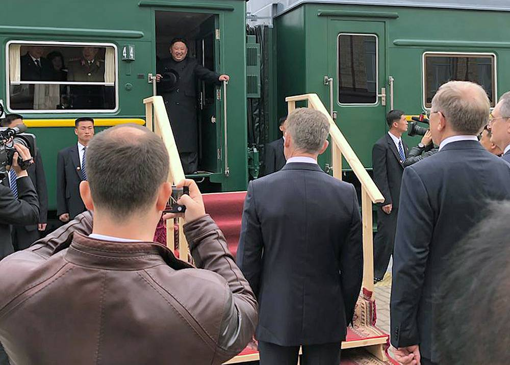 North Korean leader Kim Jong-un is welcomed as he arrives in the Russian border city of Khasan