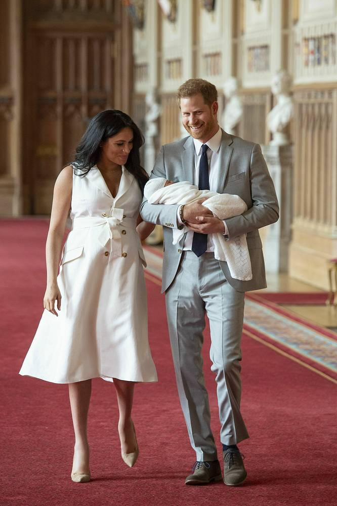 Britain's Prince Harry and Meghan, Duchess of Sussex in St George's Hall at Windsor Castle