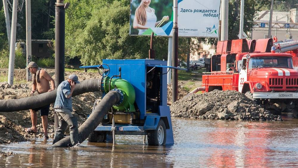August 25. Flooded Pavel Morozov street is being drained. Photo ITAR-TASS/ Dmitry Morgulis