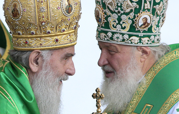 Patriarch Irinej of Serbia and Patriarch of Moscow and all Rus' Kirill before the service commemorating the Venerable Sergius of Radonezh at the Trinity Lavra of St. Sergius. July 18, 2013.