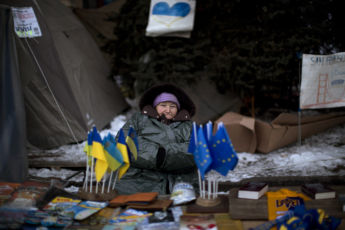 A woman sells flags of the European Union and Ukraine in a street heading to Kiev's Independence Square, the epicenter of protests