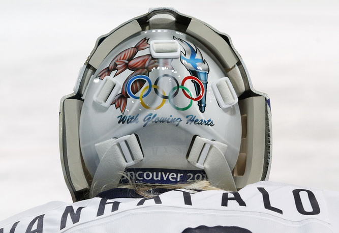 Finland's goalie Anna Vanhatalo's helmet features traditional olympic symbols