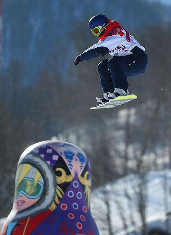 Britain's Aimee Fuller is seen with a matryoshka in the foreground during her attempt at women's Slopestyle qualifications