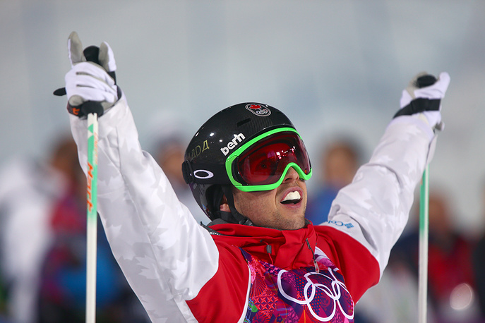 Alex Bilodeau of Canada reacts after winning Gold in the Freestyle Skiing Mens Moguls final at the Sochi 2014 Olympic Games