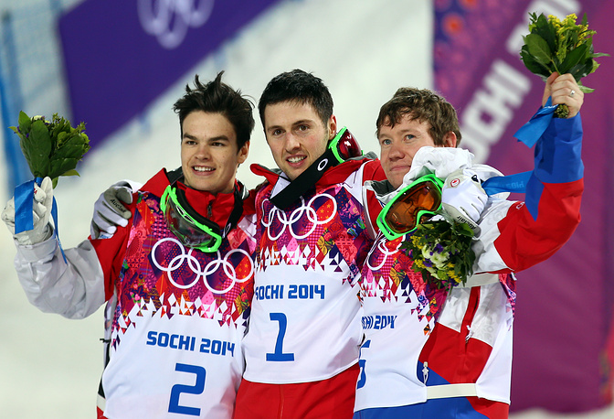 (L-R) Mikael Kingsbury of Canada, silver medal, Alex Bilodeau of Canada, gold medal and Alexander Smyshlyaev of Russia, bronze medal celebrate on the podium during the flower ceremony after winning the Freestyle Skiing Men's Moguls Final