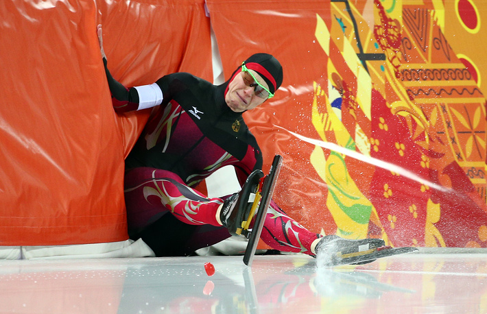 Germany's Monique Angermueller falls on the ice during the Ladies' 1000 m Speed Skating event