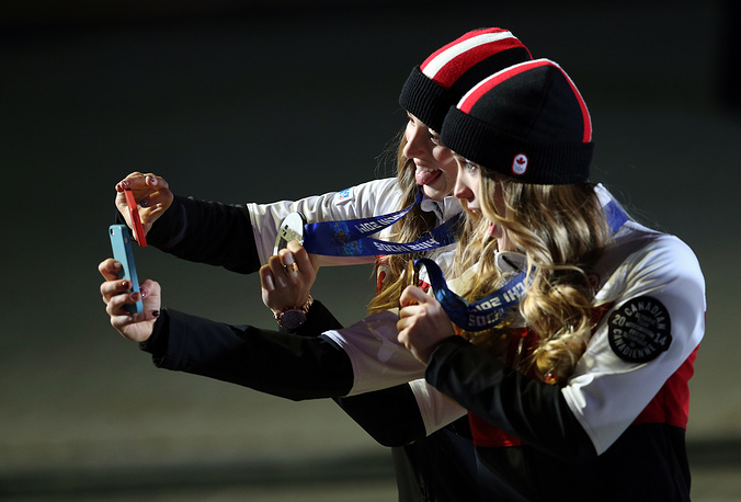 To remember the great moment, a good idea would be to take some pictures. Photo: Canada's silver medalist Chloe Dufour-Lapointe (L) and her sister, gold medalist Justine Dufour-Lapointe take a selfie after a victory ceremony