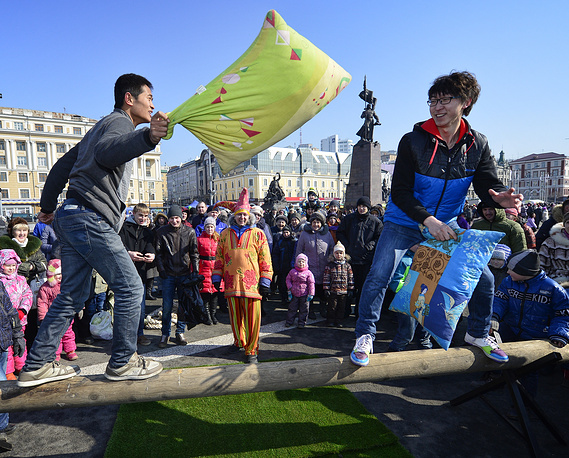 The feast was celebrated in russia's Far East as well. Photo: a pillow fight in Vladivostok