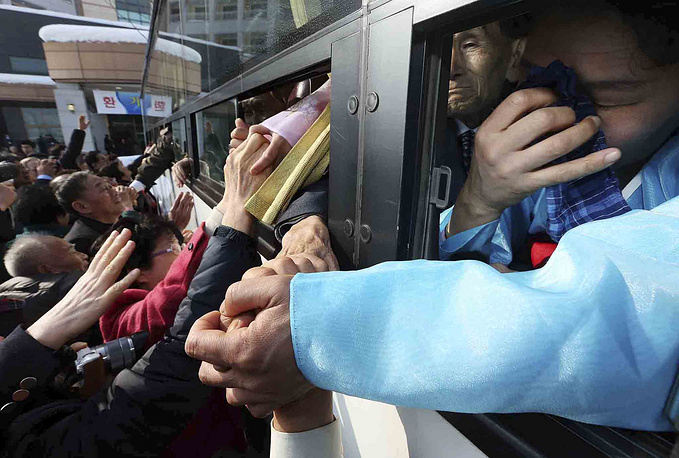 Separated families living in South and North Korea say goodbye holding hands after a brief reunion