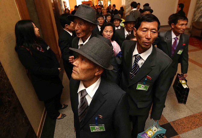 Elderly North Koreans wait to board an elevator to meet with their families and relatives living in South Korea during the inter-Korean family reunions
