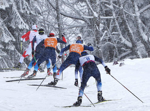 Men and their guides compete in the Cross-Country Skiing Men's 1km Sprint Free Semifinals