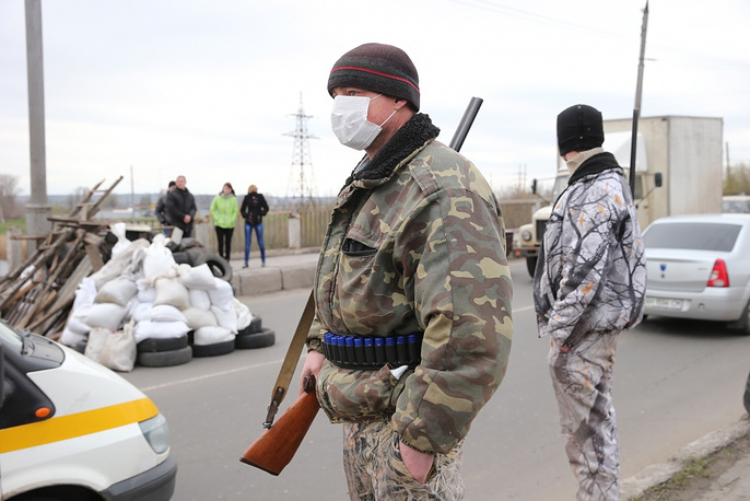 On Sunday, Apr. 13, Ukraine's acting interim Interior minister Arsen Avakov announced the start of an anti-riot operation in Slavyansk on April 13. Photo: protester guarding a block post on Slavyansk outskirts