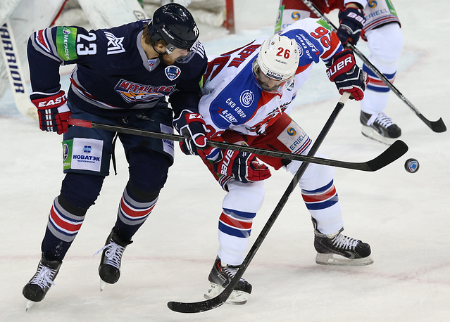 Metallurg's  Yevgeny Timkin and Lev Prague's Michal Repik