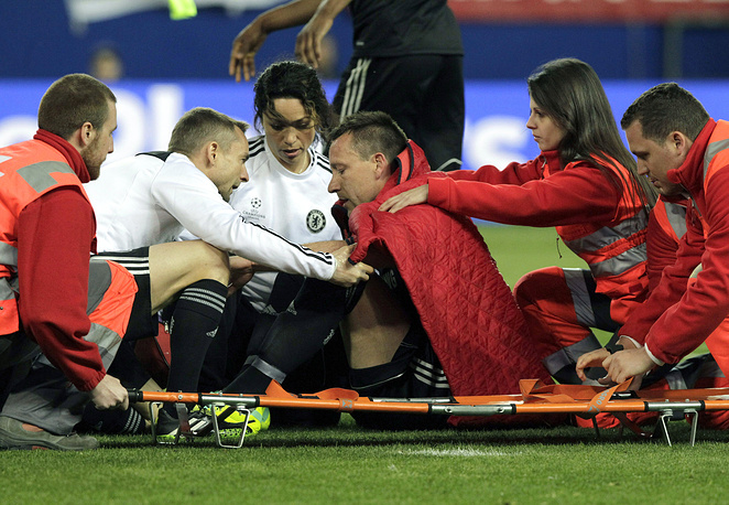 Chelsea's captain John Terry receives medical attention