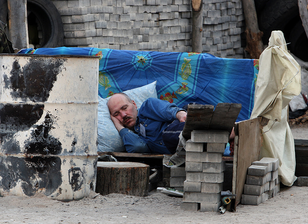 A protester sleeps at a barricade in Donetsk