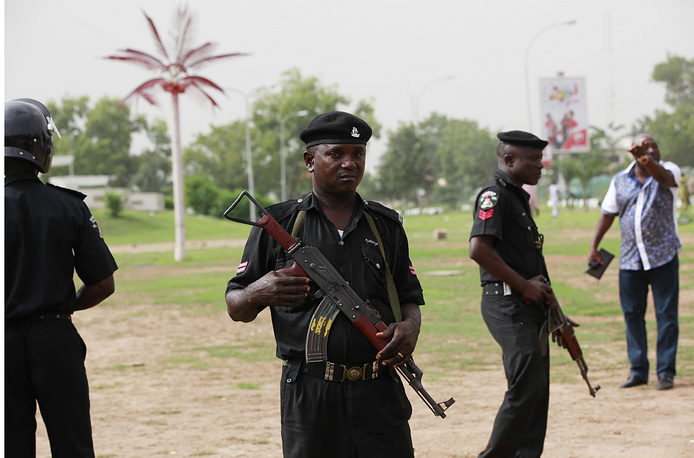 Police officers stand guard, during a rally calling on the Government to rescue the school girls kidnapped from the Chibok Government secondary school in Abuja