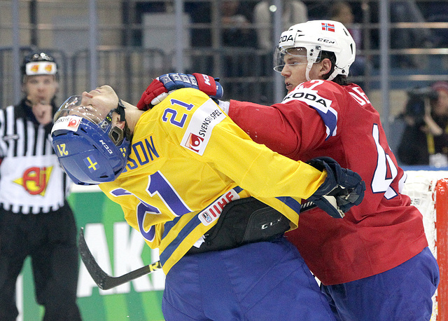 Henrik Odegaard (R) of Norway scuffles with Jimmie Ericsson (L) of Sweden