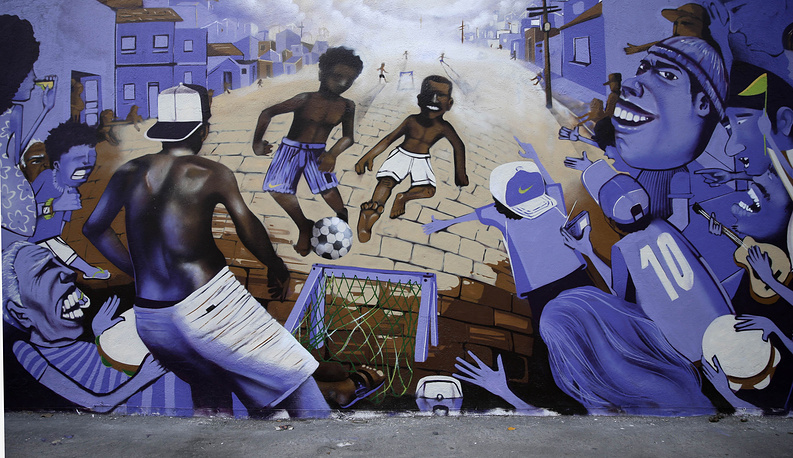 A mural depicting children playing soccer at street in favelas in Rio de Janeiro