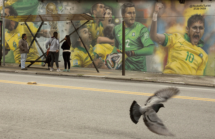 A mural at a wall by a bus stop in Sao Paulo