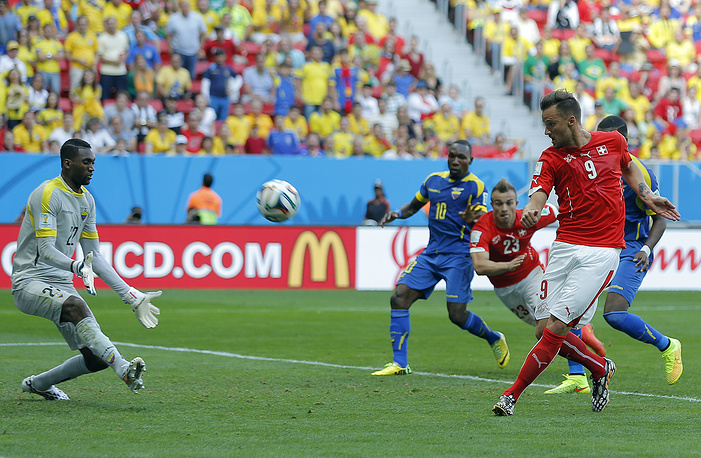 Haris Seferović of Switzerland scores his team's 2-1 lead