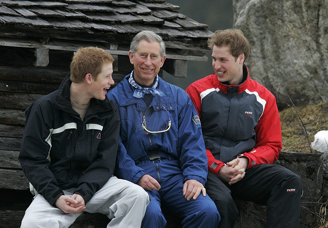 Britain's Prince Charles (center) with his sons Harry (left) and William (right)  in Monbiel near the Swiss resort of Klosters