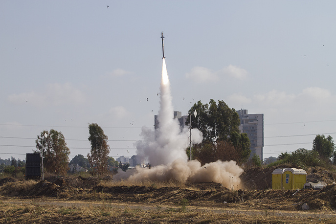 An Iron Dome air defense system fires to intercept a missile