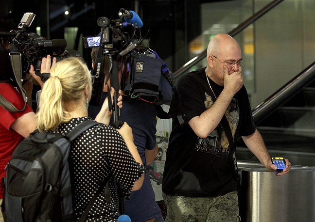 Relatives of the passengers and crew members also gather at Schiphol airport in Amsterdam
