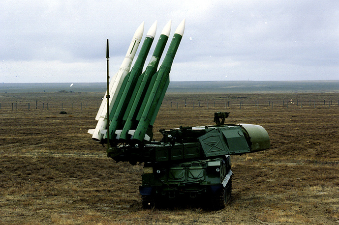 The Buk missile system is a mobile, radar-guided surface to air missile system. It has four components: acquisition and targeting radars, a command element, missile launchers, and a logistics element — mounted on tracked vehicles (photo)