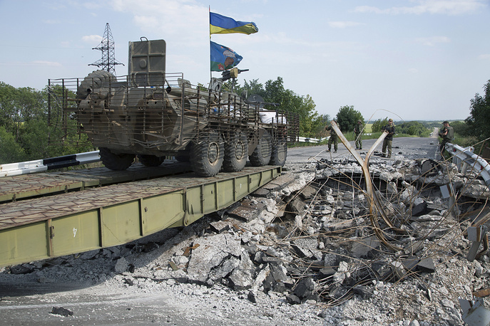 Ukrainian government army' vehicle crosses a damaged bridge  not far from Donetsk