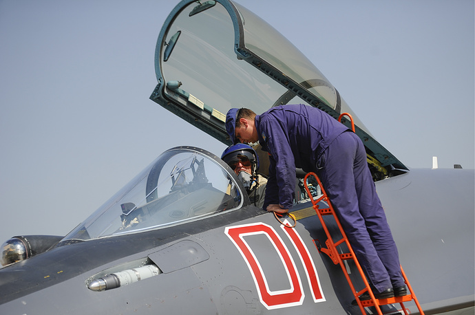A pilot gets ready to fly a Sukhoi Su-35 fighter jet