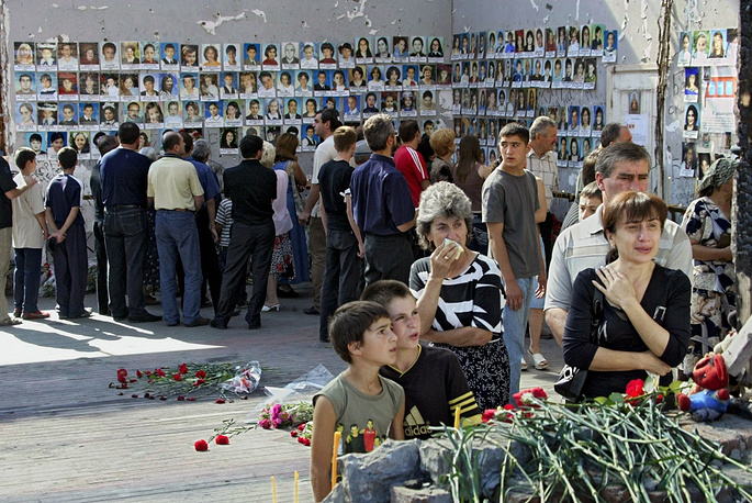 People mourn the victims on the first anniversary of the tragedy, September 1, 2005