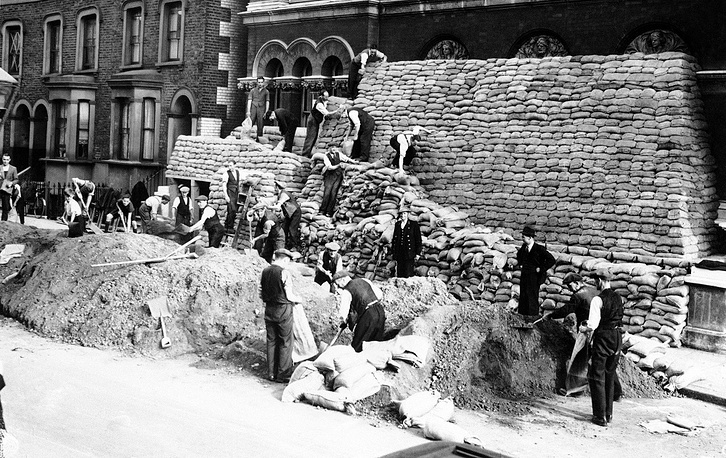 People make sand bags to protest houses from German air-raids in London, September 5, 1939