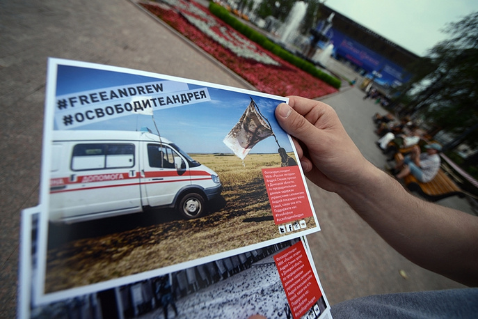 Leaflets in support of Rossiya Segodnya photo journalist Andrei Stenin during a rally in Moscow