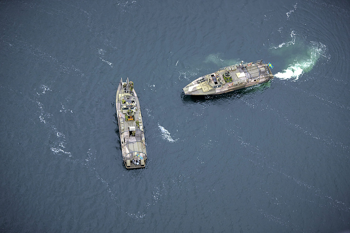 The search is conducted using high-tech equipped naval vessels, aircraft and home guard forces. Photo: Swedish Navy fast-attack vessels, Sweden, 19 October 2014