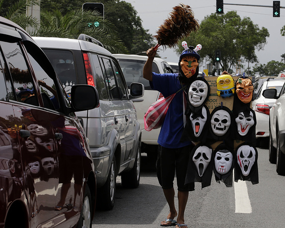 Photo: Vendor sells masks in Manila, Philippines, October 30, 2014