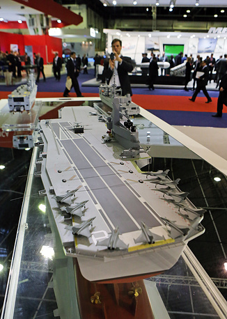 Photo: A model of a 55,000 tons aircraft carrier made by French company DCNS, presented at the Euronaval show, in Le Bourget, France, October 29, 2014