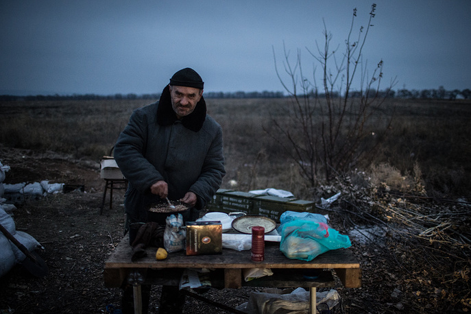 After the November 2 elections in the self-proclaimed Donetsk and Luhansk People's Republics, Ukrainian parliament registered several bills on revocation of their special status. Photo: A militiaman seen at a checkpoint in Luhansk region