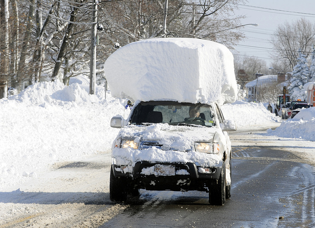 Photo: Vehicle drives along Route 20 in Lancaster, N.Y
