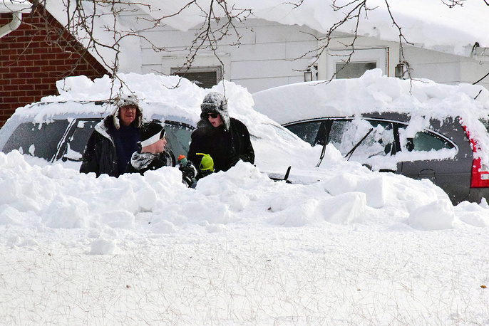 Photo: Vehicles in deep snow in a neighborhood south of Buffalo, New York