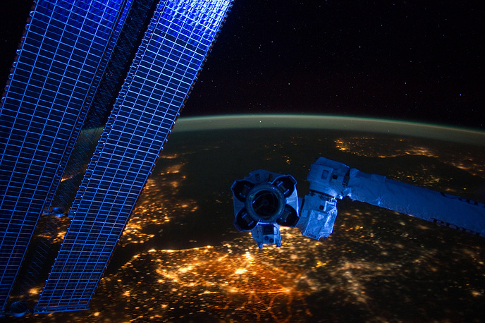 ISS crew members have an opportunity to enjoy unforgattable view. Photo: A night time European panorama revealing city lights from Belgium and the Netherlands at bottom center, 2012