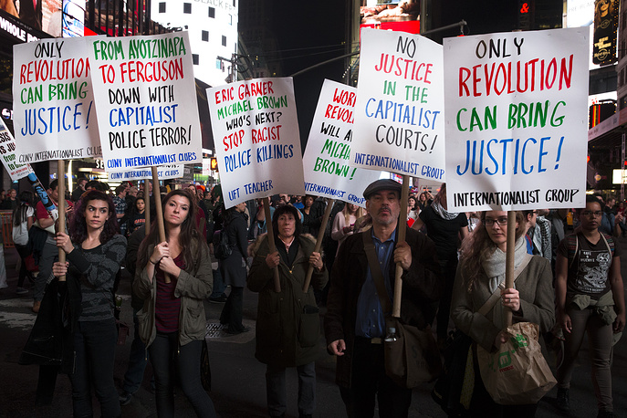 Photo: Protestors hold signs during a march into Times Square, New York